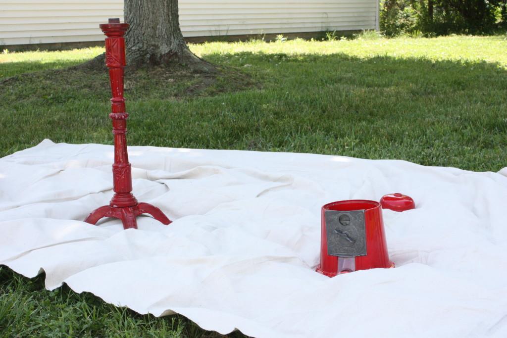 red vintage gumball machine taken apart before priming