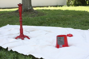 red vintage gumball machine taken apart before priming