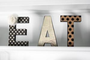 modge podge eat letters on decorative shelving
