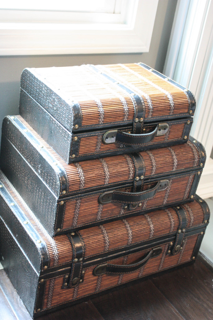 Suitcases with hole drilled through the back to hold cords and tv box