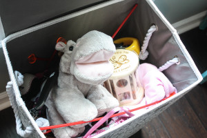 Laundry basket being used as a toy box!
