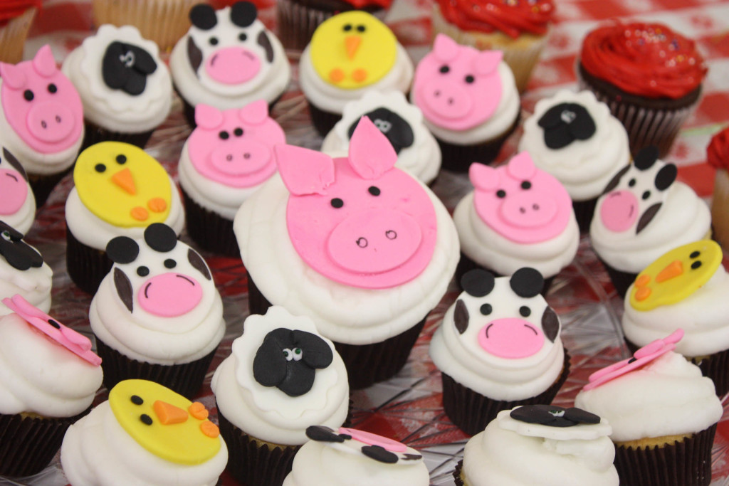 Barnyard birthday party cupcakes with farm animals on them