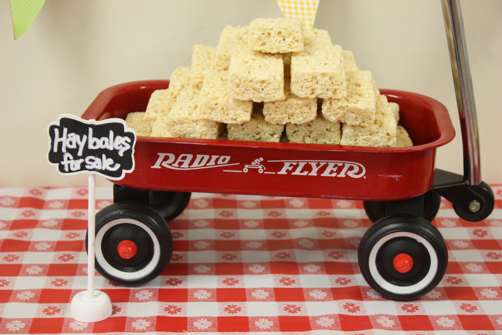Barnyard birthday party wagon with rice krispy treats as hay bales