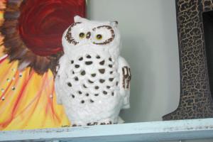 Ceramic owl on pallet coat rack