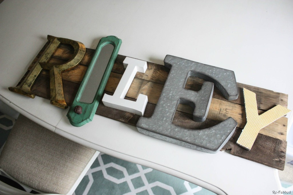 Pallet Name Sign made from pallet boards and random letters and home decor items