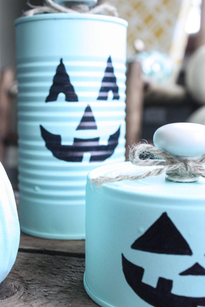 tin can pumpkins in a group
