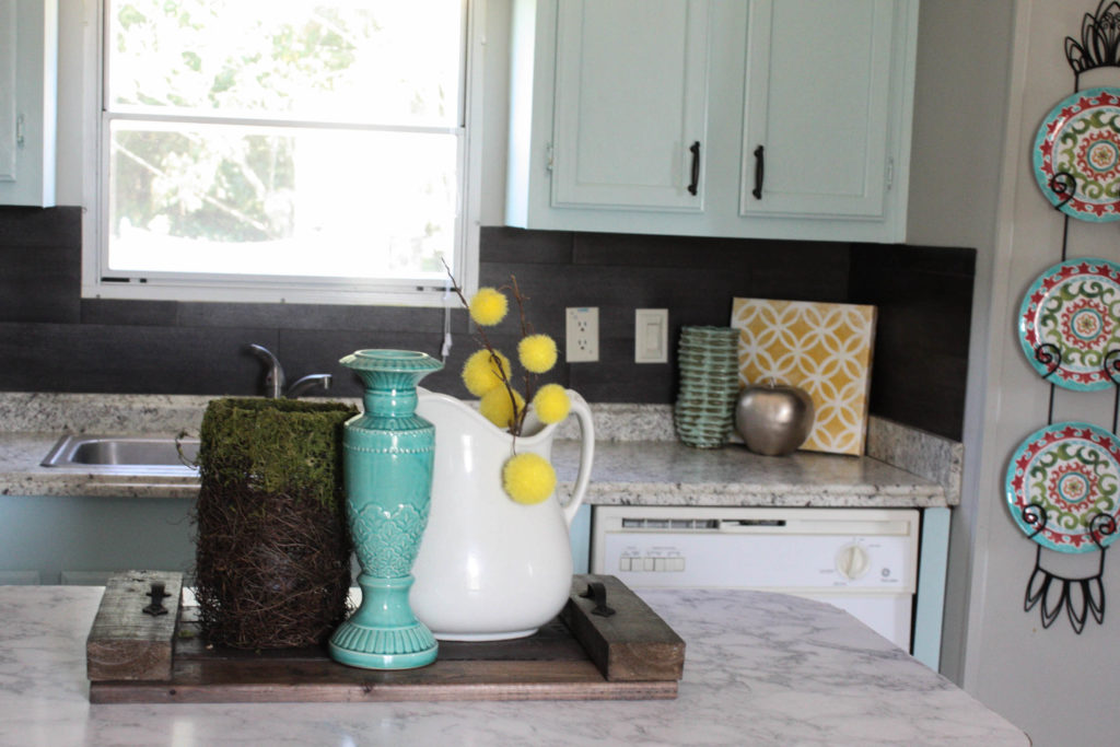 Kitchen DIYs: Great idea for using vinyl flooring as a kitchen backsplash!