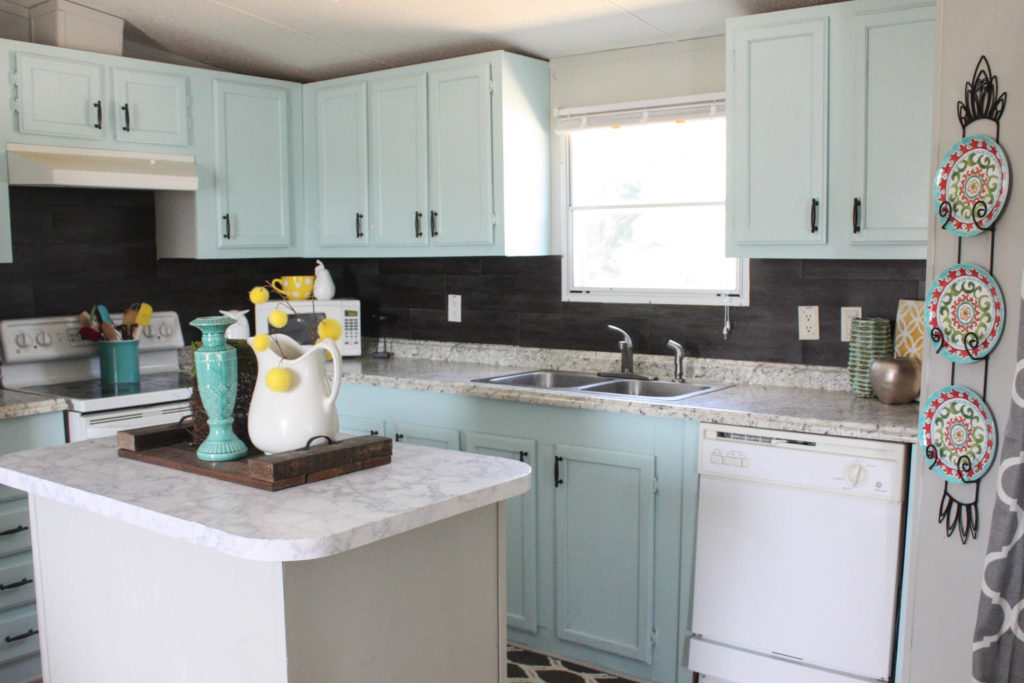 Kitchen DIYs: Installing a vinyl flooring kitchen backsplash for $40!