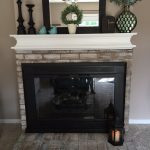 How to Whitewash Brick and Paint your Brassy Fireplace