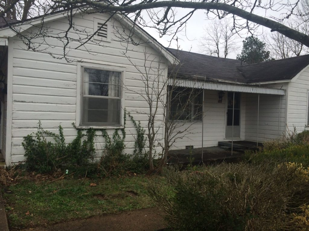 fixer upper home before picture exterior