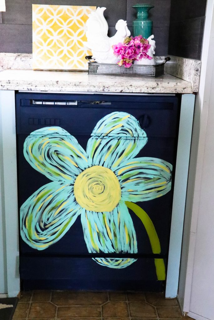 This dingy dishwasher was completely transformed with PAINT! You heard right...she painted her dishwasher! You have got to see this!