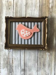 Thrift Store frame with fabric with bird attachment that can be changed with the seasons!