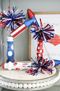Super cute fireworks using old spindles!