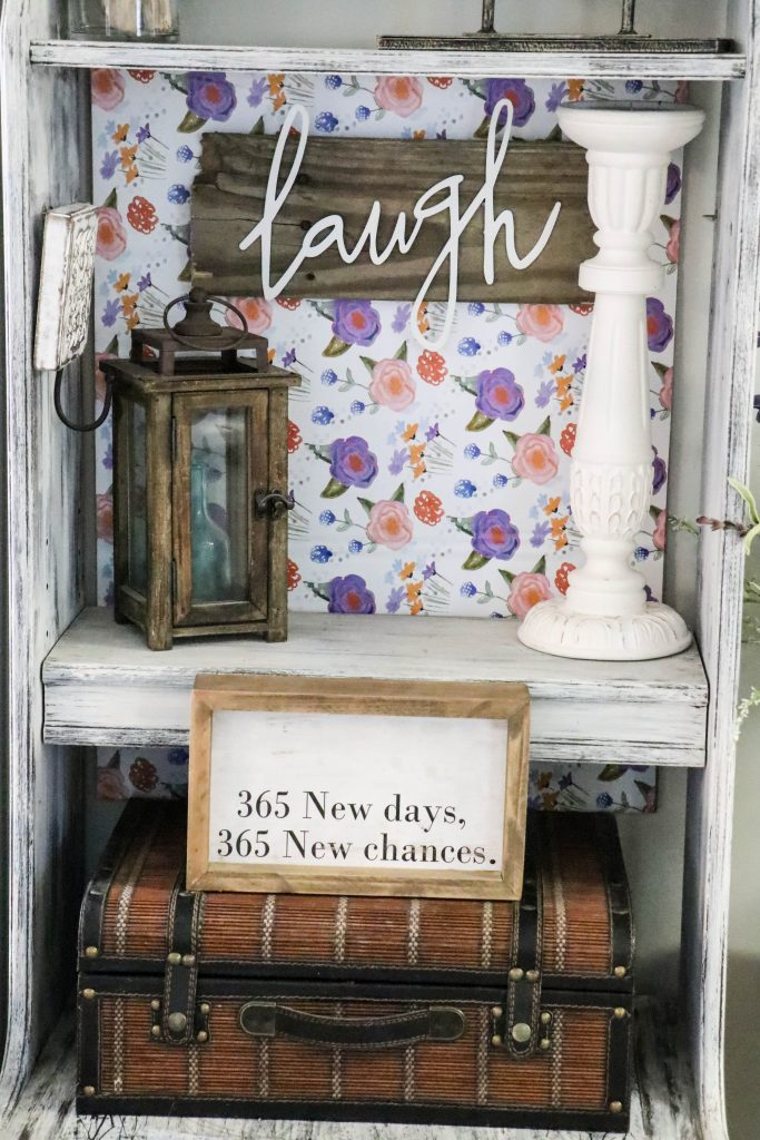 Distressed piece of furniture with background using cardboard and adhesive vinyl