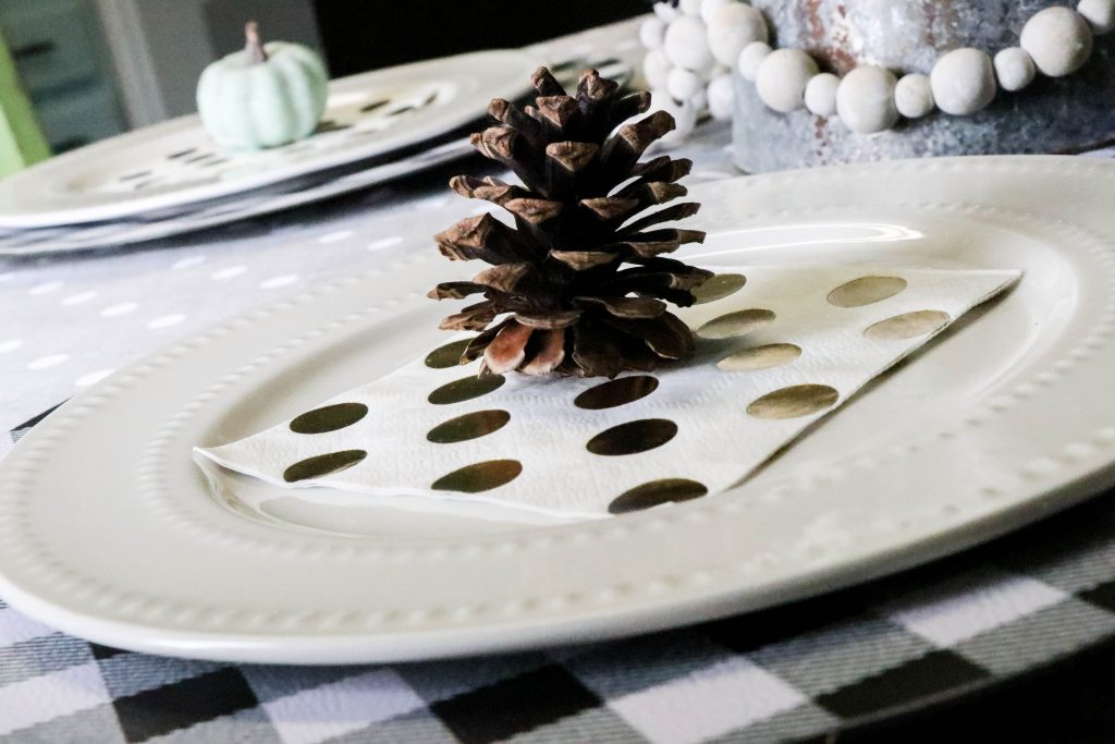 pinecone on layered fall tablescape
