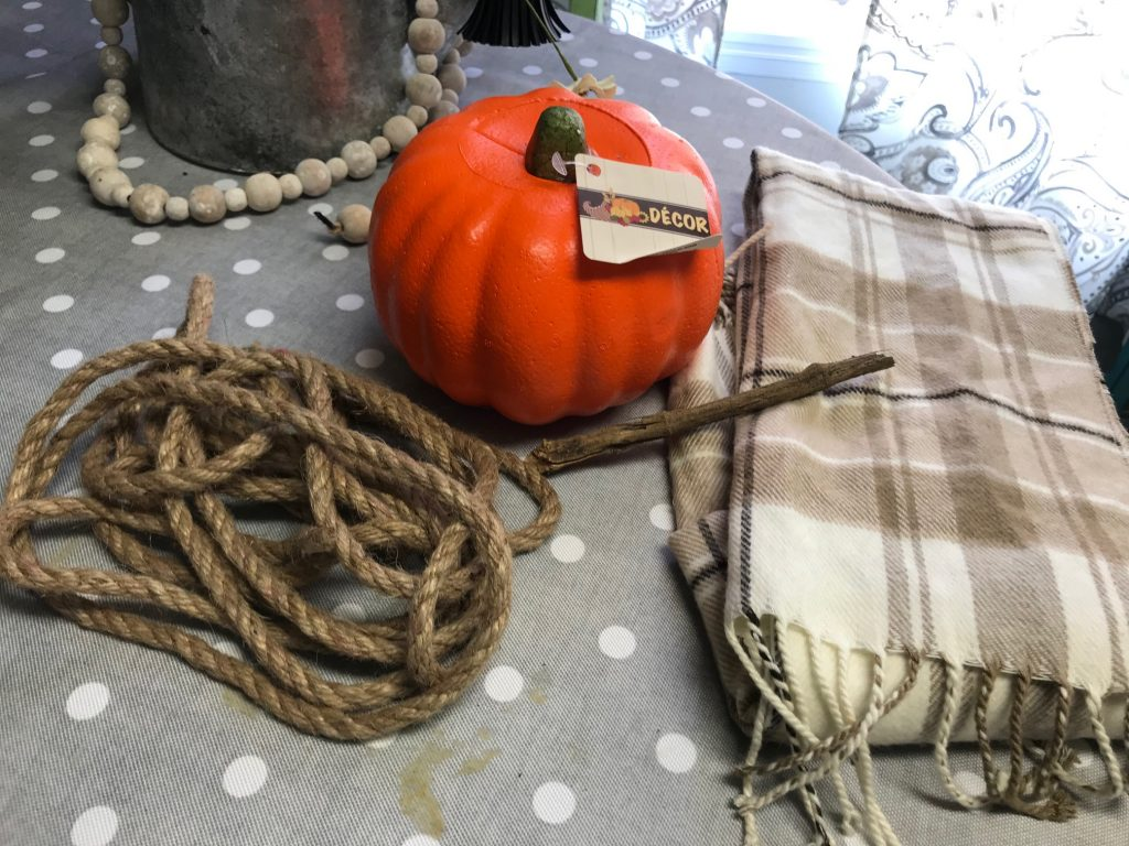 Make a super easy pumpkin with just a scarf, some sticks and a foam pumpkin!
