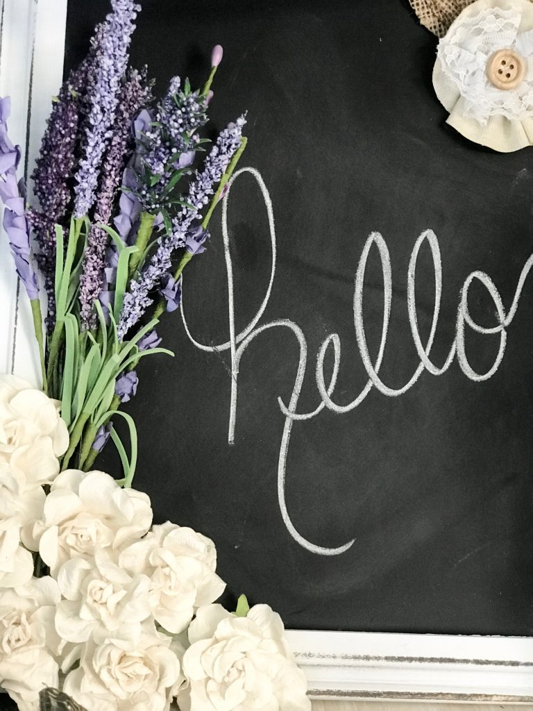 Make over a $6 Dollar General chalk board with flower embellishments!