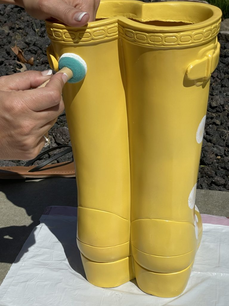yellow rubber boot flower planter from big lots painting on white polka dots