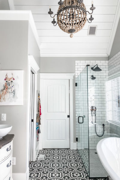 master bathroom view with beaded light fixture
