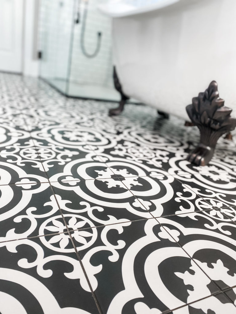 black and white flooring and clawfoot tub