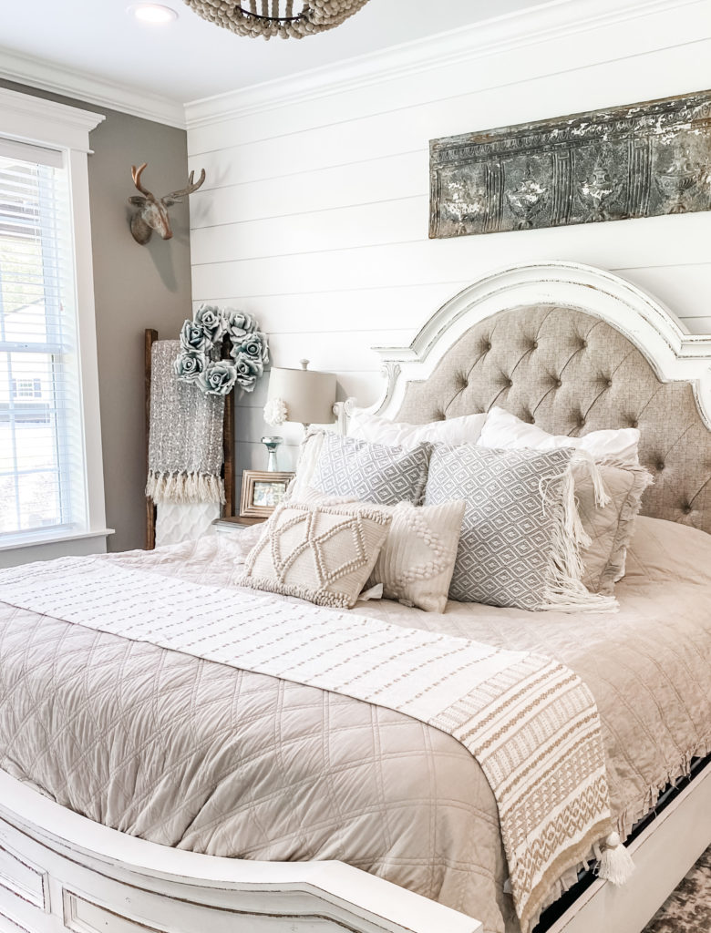 neutral bedding with table runner on end