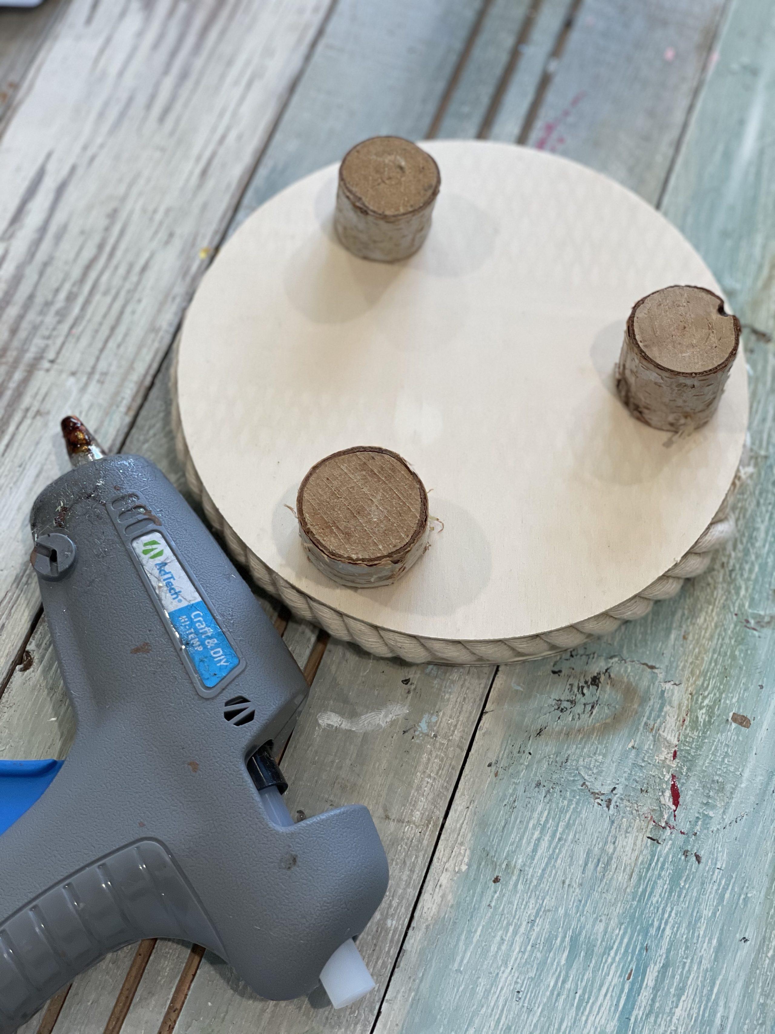 hot glue the wooden feet
