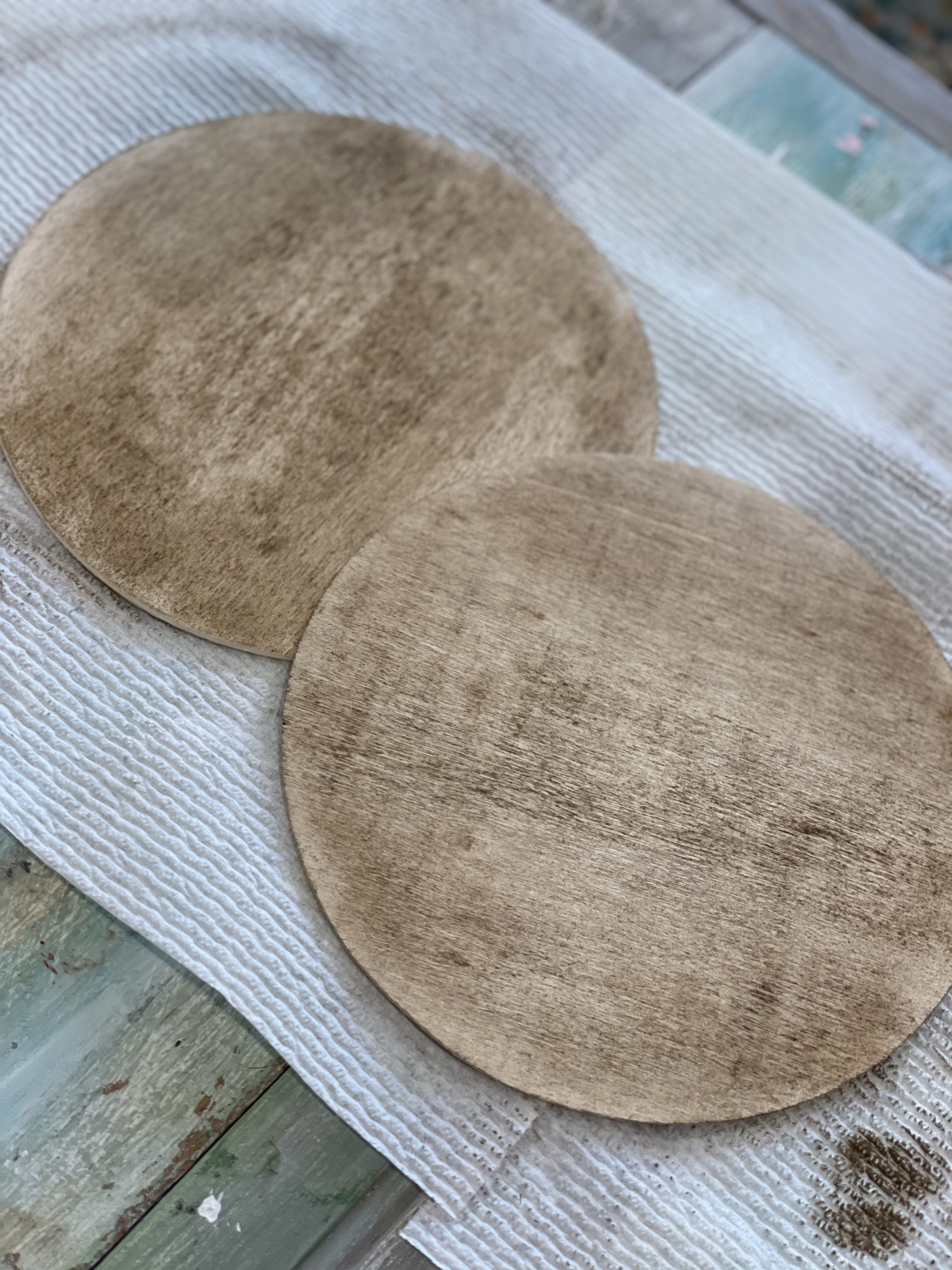 both stained wooden circles