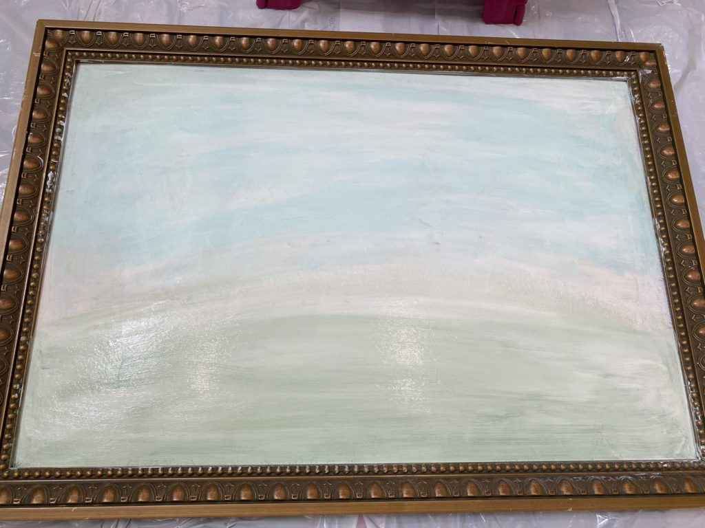 goodwill painting in the process of being painted for wildflowers. painted the backdrop white and added blue and green to the bottom