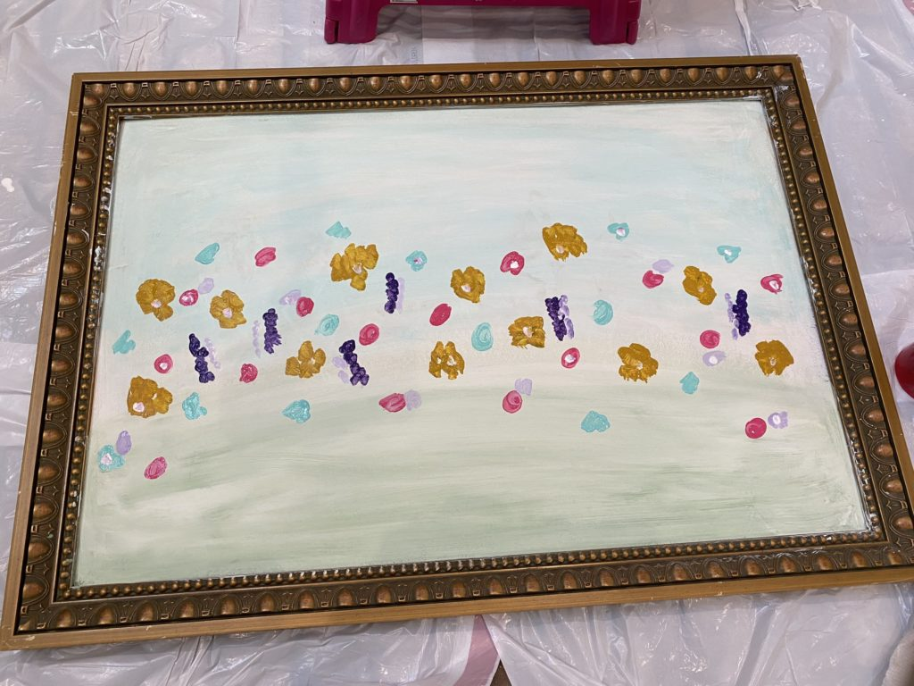 """began adding """"flowers"""" to the painting. adding in pink, aqua, and purple"""
