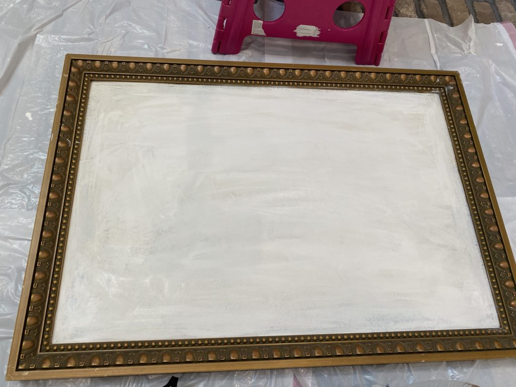 goodwill painting in the process of being painted for wildflowers. painted the backdrop white