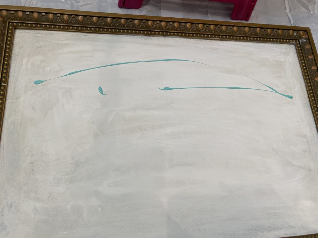 goodwill painting in the process of being painted for wildflowers. painted the backdrop white and added blue