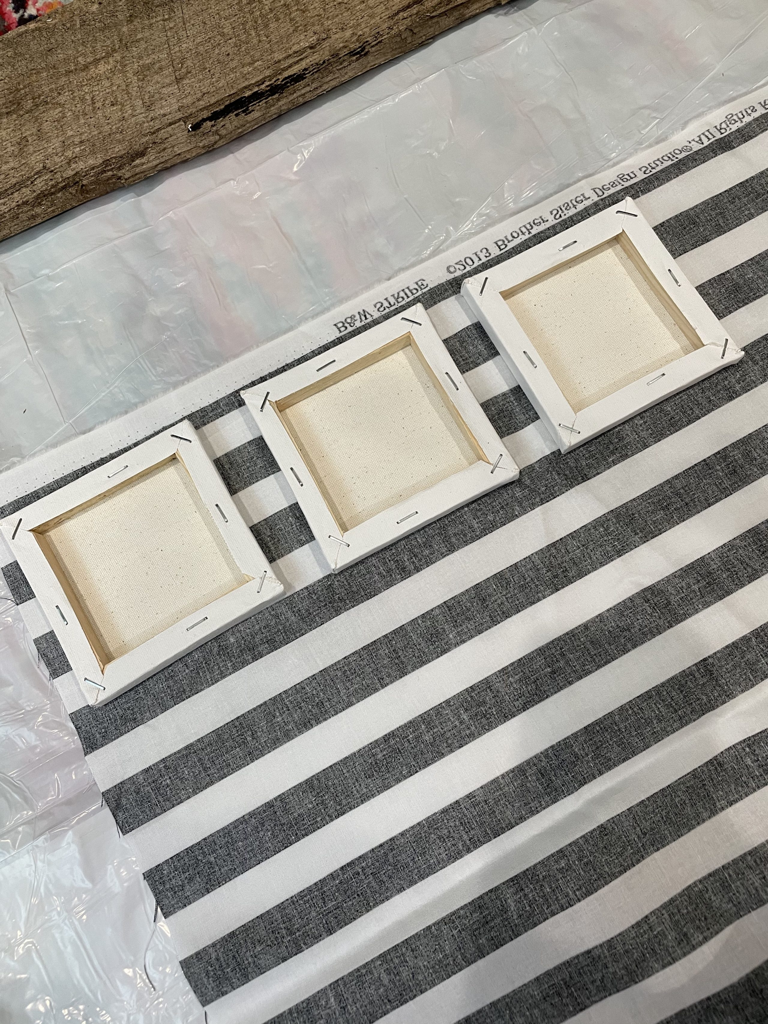 covering the canvases with striped fabric
