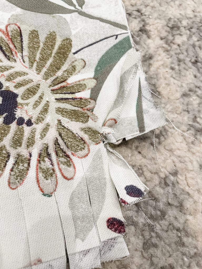 how to make a diy tied rag throw pillow - tie your strips into knots