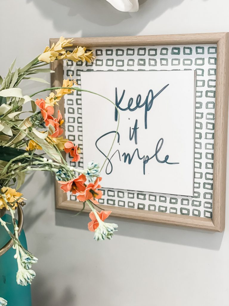 keep it simple wood sign in office