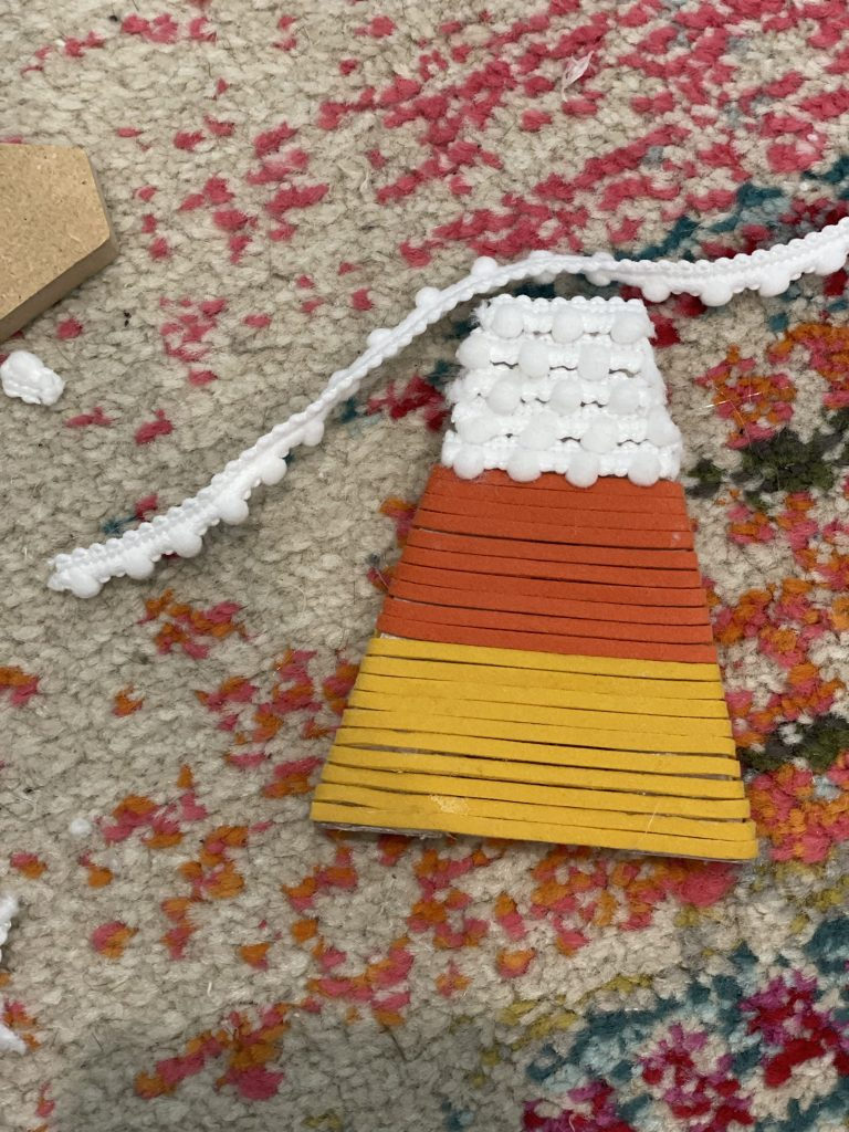 wrap your letter with the third color of cord