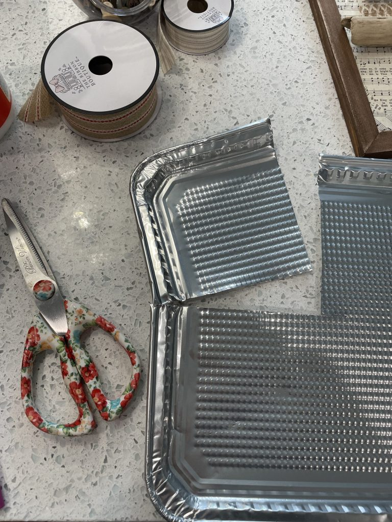 use dollar tree cookie sheet to make rustic star