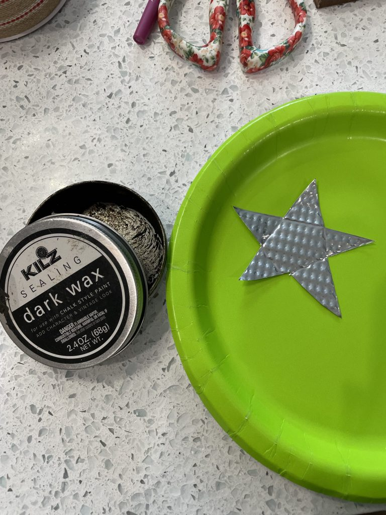 use dollar tree cookie sheet to make rustic star and stain