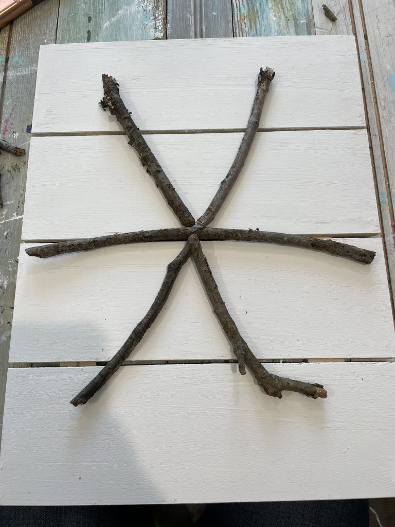 start forming your sticks into a snowflake