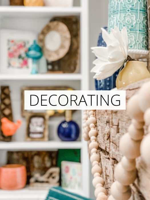 white shelf with home decor elements