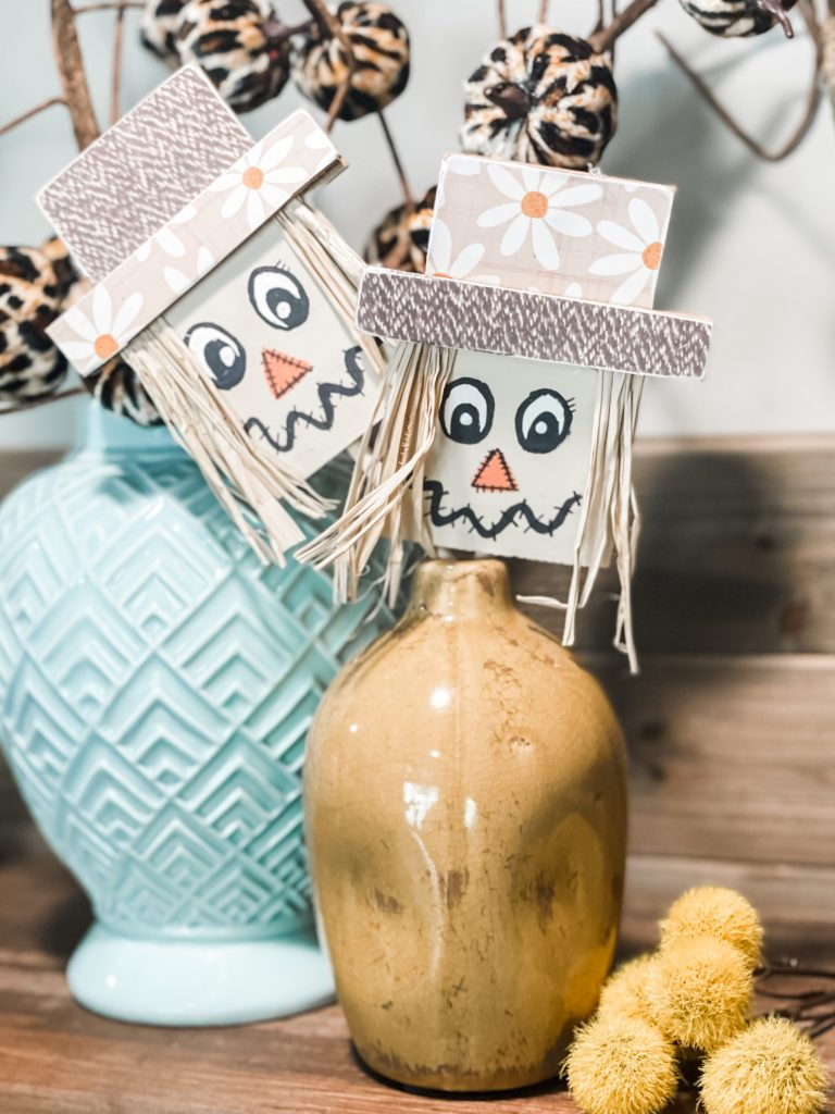 put the scarecrow inside the vase and done!