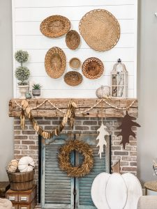 view of fall mantel decorated with baskets and neutral elements