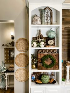 left side of built in shelving decorated for fall