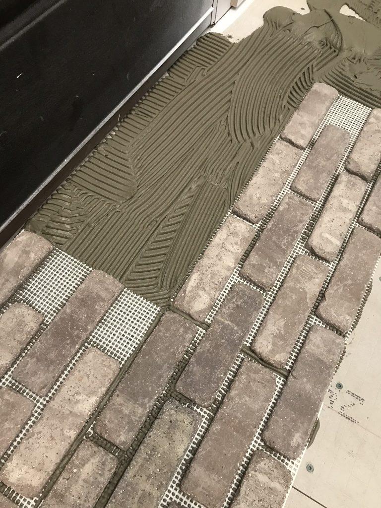 how to install brick flooring