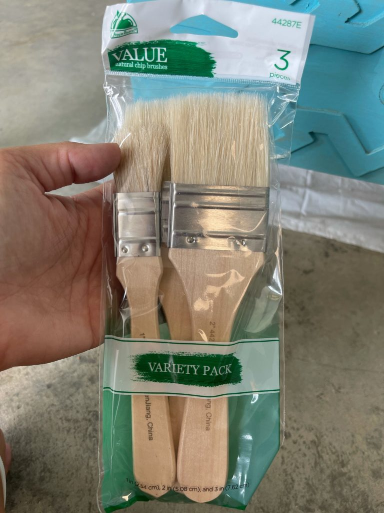 pack of paint brushes used to paint this side table