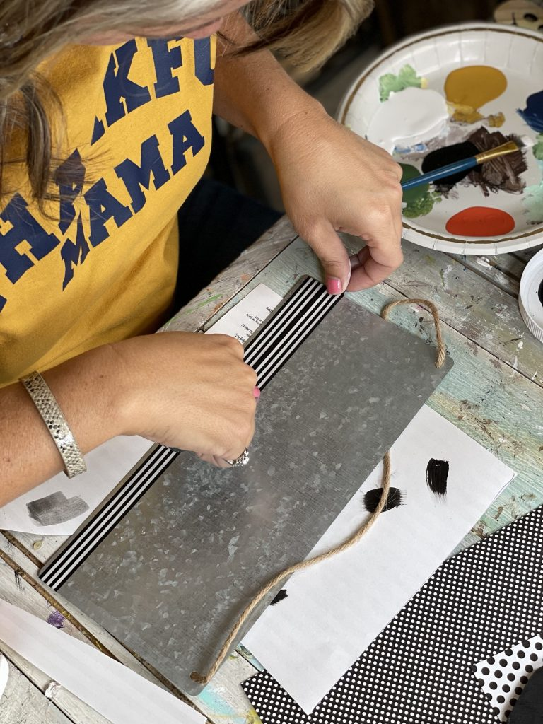 add black and white washi tape to the bottom of the galvanized sign