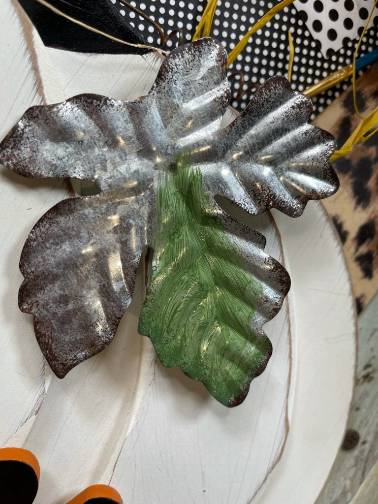 paint over the galvanized leaves with green paint