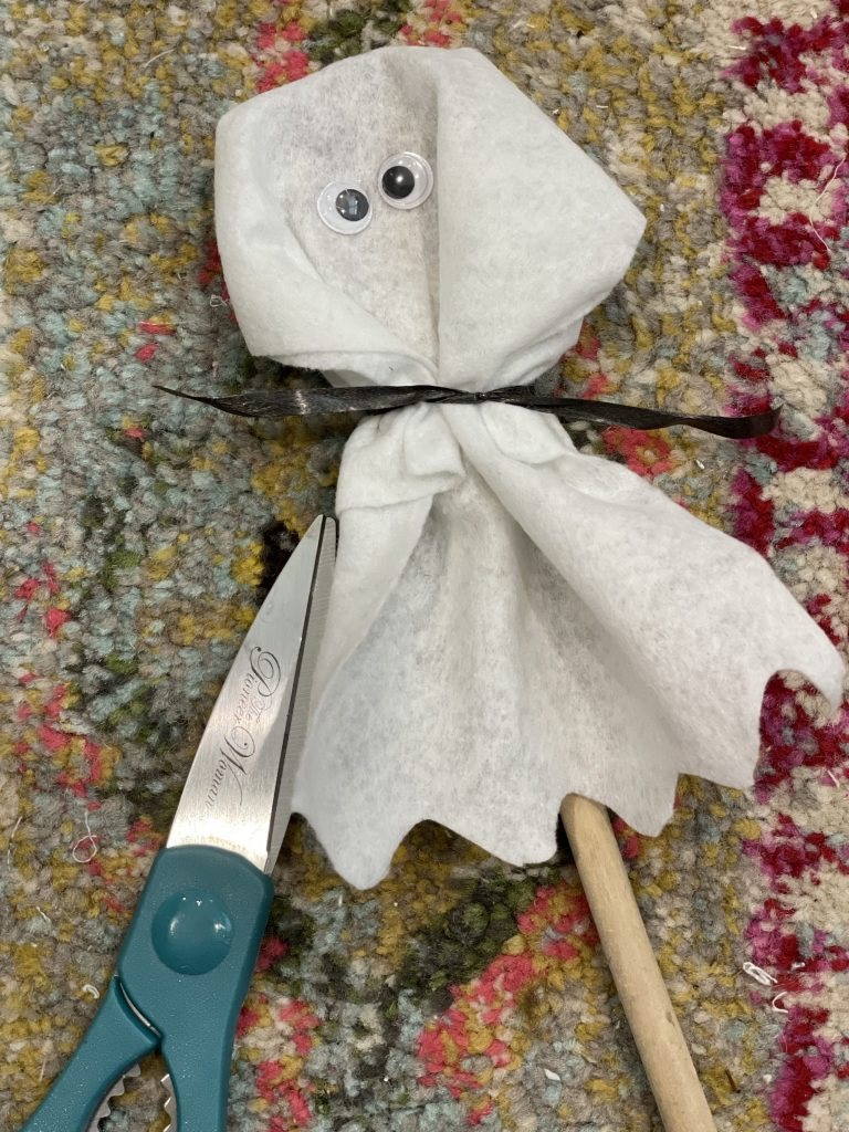 cut the bottom of the felt to mimic a ghostly figure