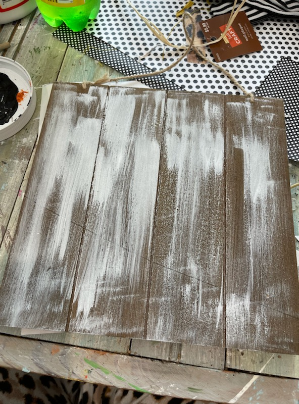 White wash your board by brushing on white paint