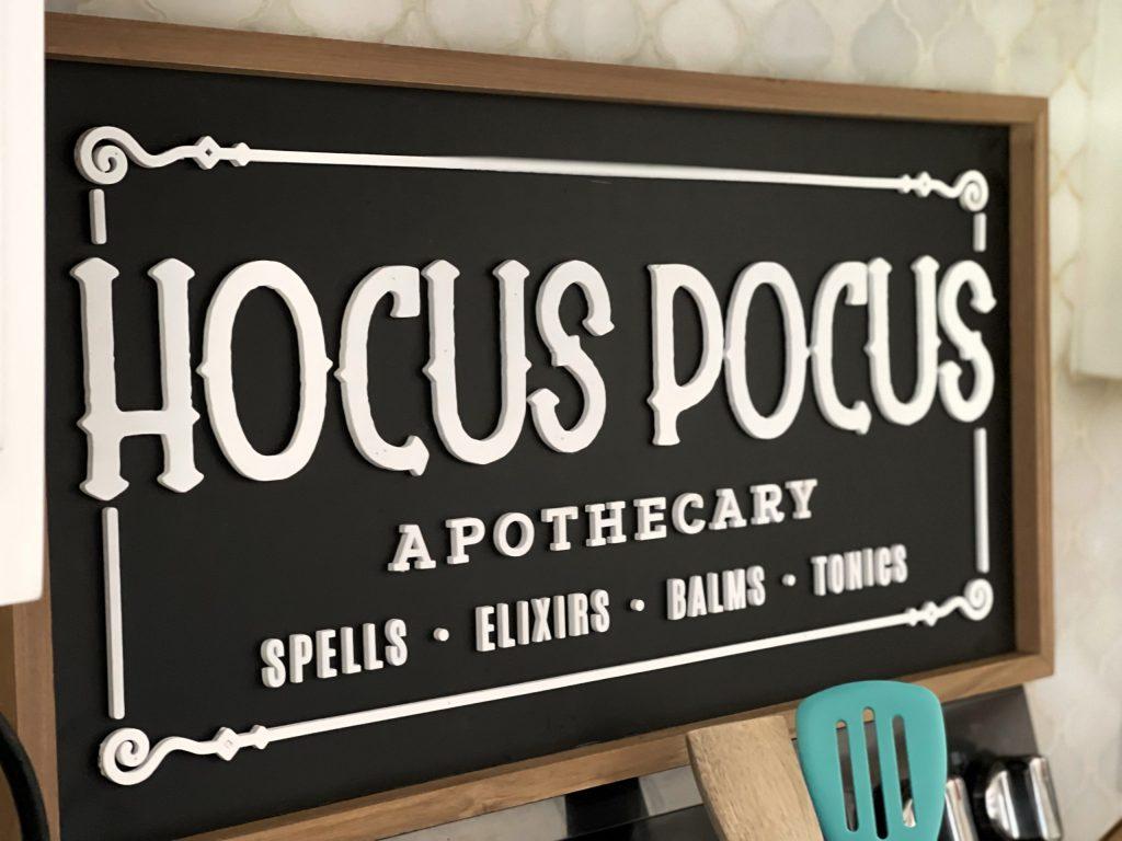 hocus pocus sign above stove