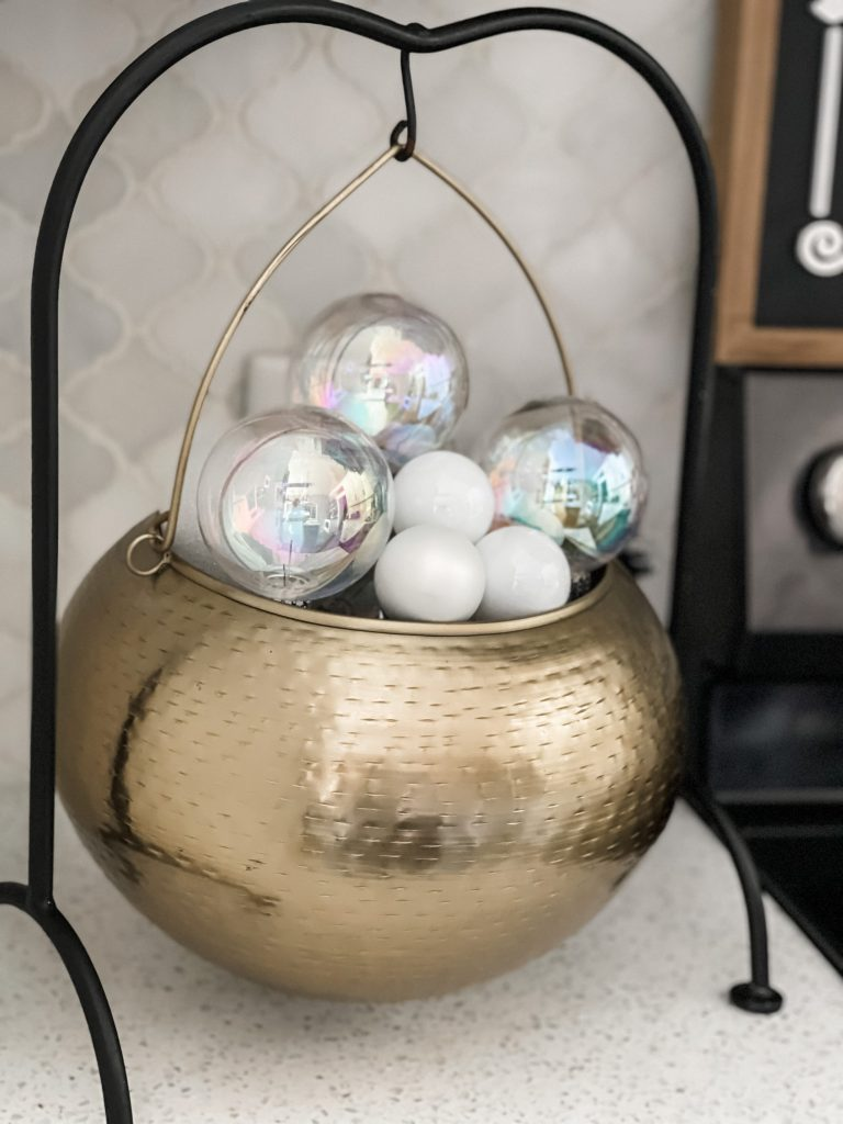 golden cauldron with clear ornaments as bubbles